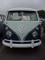 Photo shows front end of a Volkswagen 13-window deluxe bus