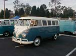 Restored Volkswagen 13 window deluxe bus painted sea blue on bottom half