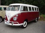 Volkswagen 13-window deluxe bus is painted titian red on the lower part
