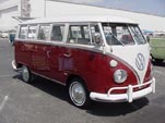 Beautifully restored Volkswagen 13-window deluxe bus with stock titian red paint job