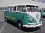 VW 13-window deluxe bus with custom graphics on the sides