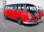 Beautiful custom VW 13-window deluxe bus is slammed and painted black over cherry red