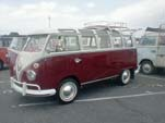 Volkswagen 21-window samba deluxe bus painted titian red on the bottom half