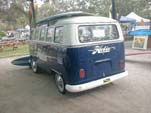 Sea blue vintage VW 21-window samba bus with a large Hobie Surfboards decal on back