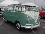 Restored VW 23-window deluxe samba bus with stock L380 turquoise paint on lower half