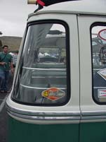 Detail view of the curved rear window on a VW 23 window deluxe samba bus