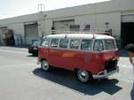 Vintage Volkswagen 15-window deluxe bus painted selaing wax red on lower half