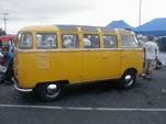 Yellow Volkswagen 23-window deluxe samba bus with pressed bumpers