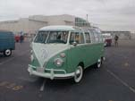Vintage Volkswagen 23-window deluxe samba bus with wide white wall tires