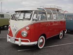 Vintage Volkswagen 23-window bus samba deluxe with wide white walls