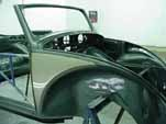 Spray the 2-tone green paint coats on the 1954 VW convertible