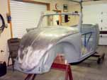 Pound out and heat-shrinnk the 1954 VW convertible front hood