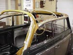 Beautifully finished new wood convertible top frame on a 1954 Volkswagen convertible bug