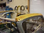 Photo shows the new wood header beam installed on the restored 1954 Volkswagen convertible bug