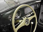 Rare batwing steering wheeel in 1954 Volkswagen convertible bug has been restored and painted