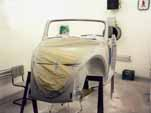 Begin priming the body as part of the 1954 VW convertible restoration