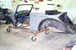 1954 VW Cabriolet is mounted on a rolling dolly so the bodywork can continue