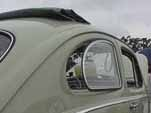 Restored Volkswagen bug has factory sunroof and side pop-out windows