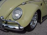 Photo shows close-up view of a restored VW bug sedan