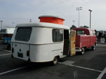 VW Double Cab Pickup towing a vintage Eriba Puck travel trailer
