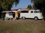 Great Looking Rig is a VW Double Cab Pickup Towing a Vintage Eriba Puck Travel Trailer Setup For Camping