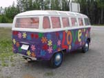 Hippy love paint job on old VW 23-window deluxe bus