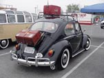 Vintage VW bug painted flawless black and with vintage accessories