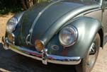 Photo shows vintage yellow front fog lights installed on the restored 1954 Volkswagen convertible bug