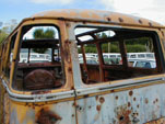 Wrecking yard with Classic 23-Window Samba bus - lots of holes!
