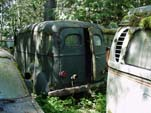 Forgotten Volkswagen Salvage yard With VW T2 Bay Window Bus and Vintage Ford Panel Truck